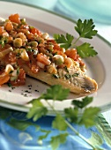 Pike-perch with tomatoes and spring onions