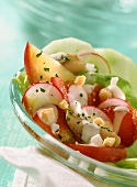 Matje herring salad with peach and strawberries
