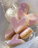 Pink sweet pastry hearts with jam filling
