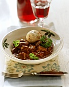 Goulash with one bread dumpling