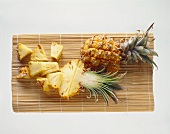 Baby pineapple, half a pineapple & pineapple pieces