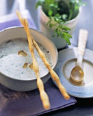 Whipped cream cheese soup with garlic and rocket