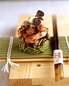 Duck breast strips on green Japanese noodles
