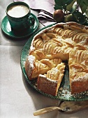 Sunken apple cake and a cup of coffee