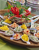 Colourful rice salads on Asian spoons