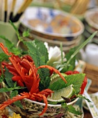 Asian table decoration with herbs & carved chili peppers