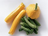 Green and yellow mini-courgettes and mini-patty pan squashes