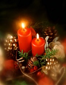 Christmas flower arrangement with burning candles