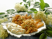 Deep-fried elderflowers with orange cream