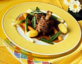 Braised kid with vegetables in lemon and thyme jus