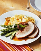 Roast pork roll with green asparagus and ribbon noodles