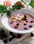 Cold blackberry soup with pear slices