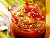 Rhubarb chutney with red onions in a jar