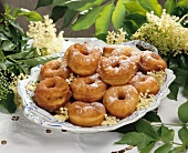 Coiled doughnuts (Schmalzkringel) with elderflowers