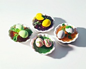 Coloured eggs on vegetables in aspic
