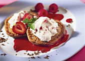Chocolate buns with strawberry cream