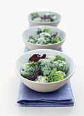Spinach dumplings in bowls