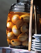 Pickled hard-boiled eggs (Solei) in a jar