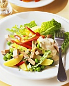 Mixed salad with potatoes and strips of turkey