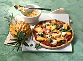 Pizza with ham and pineapple