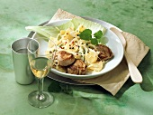 Port medallions with pineapple and white cabbage casserole