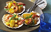 Fried potatoes with scampi and rocket on scallop shells