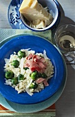 Brussels sprout risotto with strips of ham and Parmesan