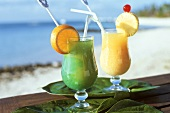 Two exotic cocktails on seashore