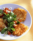 Cheese and potato rosti with corn salad