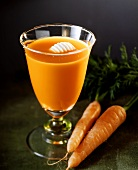A glass of carrot juice with butter curls