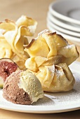 Crepe pouches filled with figs, with scoop of ice cream