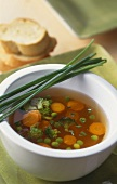 Clear vegetable soup with chives