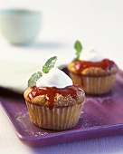 Berry muffin with cream topping and mint leaf