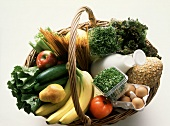 Wicker basket with various foodstuffs