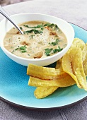 Potato and peanut soup with spinach and chicken