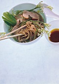 Japanese noodle soup with salmon and chives