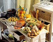 Brunch buffet with roast ham, muffins, salad and fruit