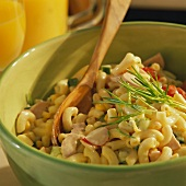 Pasta salad with cherry tomatoes, radishes and sausage