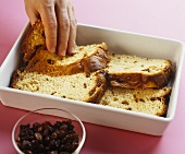 Laying panettone slices in baking dish