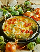 Brussels sprout gratin with onions and sausage