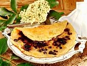 Sesame pancake with elderberries