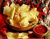 Corn chips with spicy pepper sauce