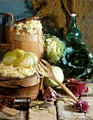 Sauerkraut in wooden barrels, with cabbages beside them