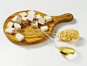 Soya products on a board and spoons