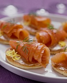 Blinis with salmon rolls