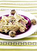 Matje herring and potato salad garnished with quail's eggs