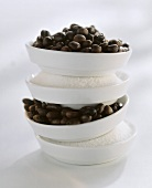 Sugar and coffee beans in a bowl, piled on top of each other