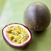 Passion fruits, whole and halved (purple granadilla)