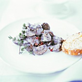 Button mushrooms with red peppercorns in cream sauce
