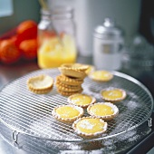 Lemon tartlets on draining rack